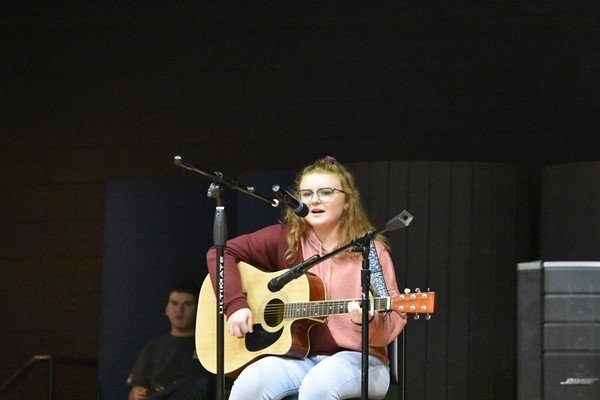 Lauren Tabler sang and played guitar for the crowd